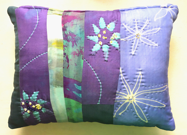 Silk scatter cushion.  Batik fabric patchwork with quilting.