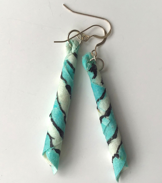 Earrings, hand decorated stiffened cotton with silver hooks