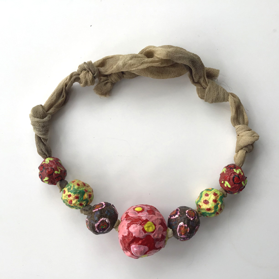 Large papier mache beads threaded on naturally dyed silk