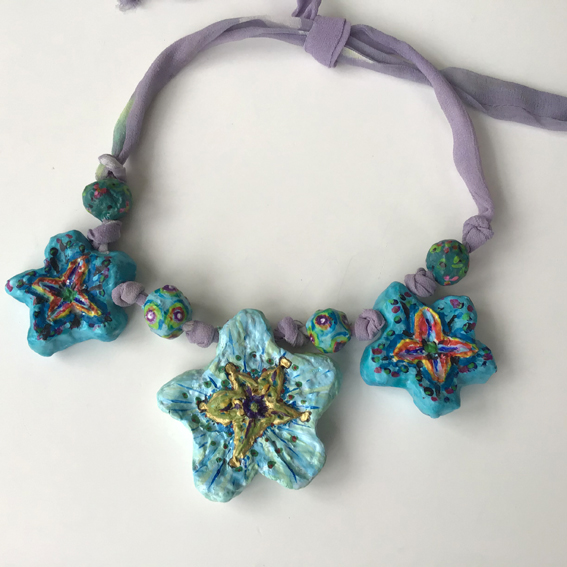 Large papier mache beads threaded on hand dyed silk